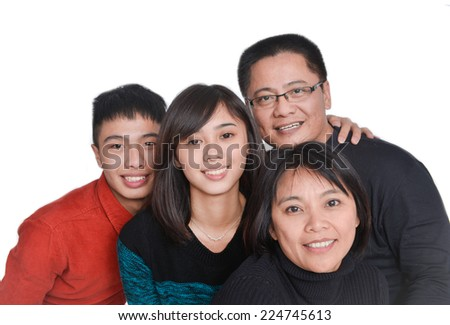 Asian family looking very happy - stock photo