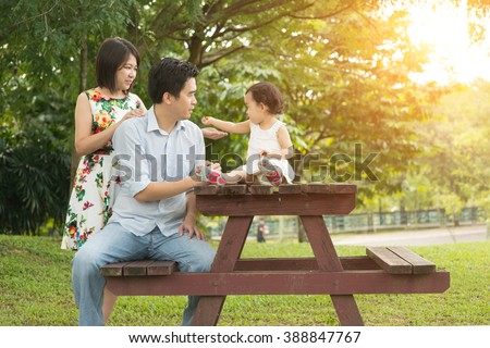asian family outdoor - stock photo