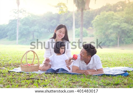 Asian family picnic in the park - stock photo