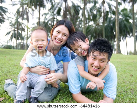 Asian family playing in the park - stock photo