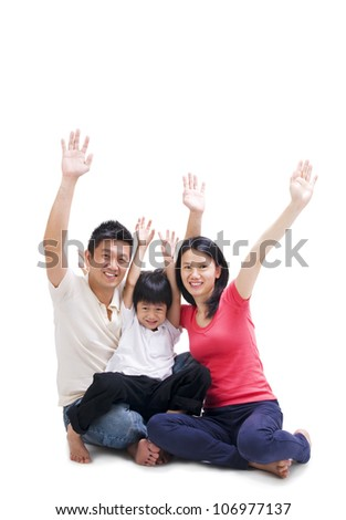 Asian family raise their hands - stock photo