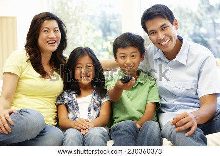 Asian family watching television - stock photo
