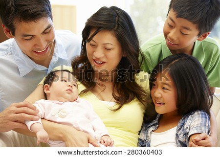 Asian family with baby - stock photo