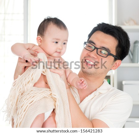 Asian father and six months old baby girl - stock photo
