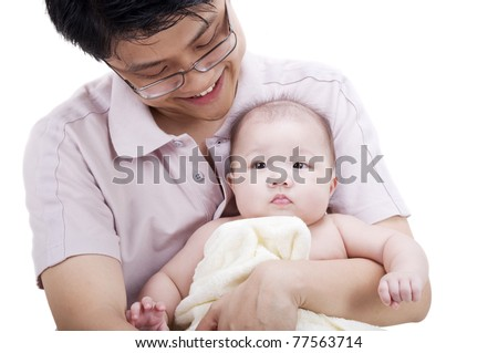 Asian father holding his 4 months old baby girl - stock photo
