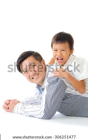 asian father piggyback his son - stock photo