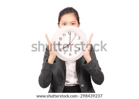 Asian female business executive holding up clock - stock photo