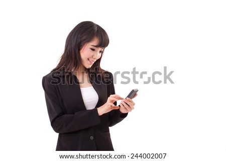 asian female business woman executive texting, messaging, using smartphone application with touchscreen technology - stock photo