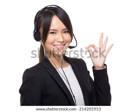 Asian female customer services with ok sign - stock photo