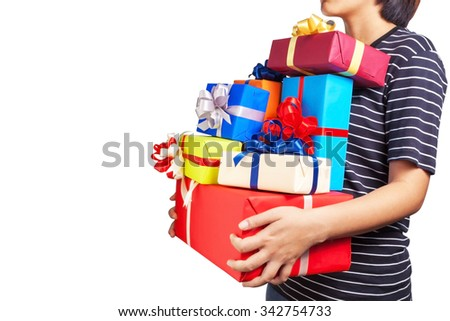 Asian female holding a lot of Christmas gifts in her hands - stock photo