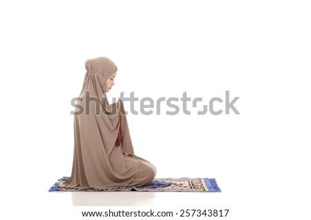 Asian female muslim praying isolated on white background. - stock photo