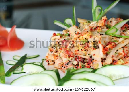 Asian fish salad cucumber butterfly garnish - stock photo