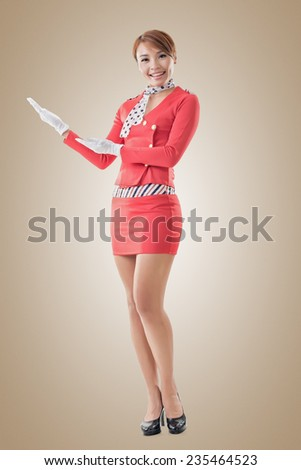 Asian flight attendant portrait, full length isolated. - stock photo