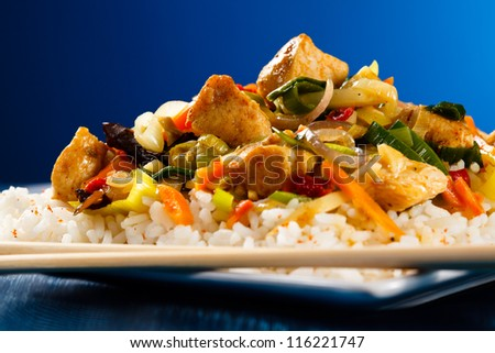 Asian food - chicken with vegetables and rice - stock photo
