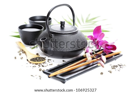 Asian food concept (Green tea, orchid and chopsticks) - stock photo