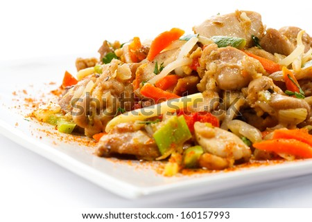 Asian food - roast meat with vegetables - stock photo