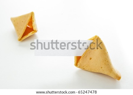 Asian fortune cookie with blank paper isolated on white background. - stock photo