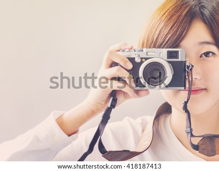 Asian Girl Camera Photographer Focus Shooting Concept - stock photo
