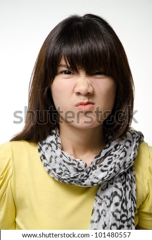 Asian girl does an angry face - stock photo