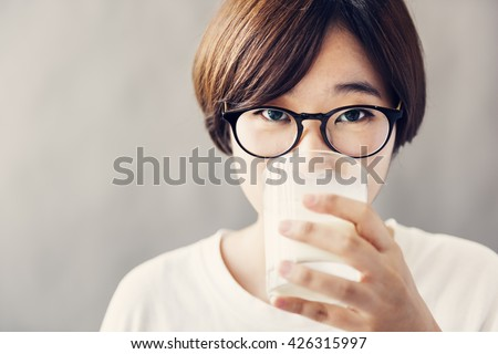 Asian Girl Drinking Milk Beverage Grow Up Relaxation Concept - stock photo