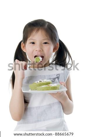 Asian girl eating cakes - stock photo