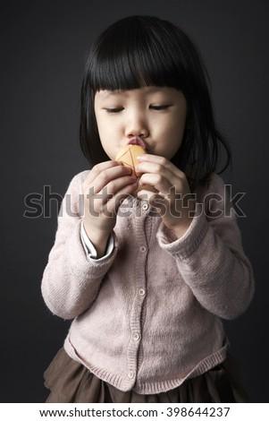 Asian girl eating Dessert, shot in studio.  - stock photo