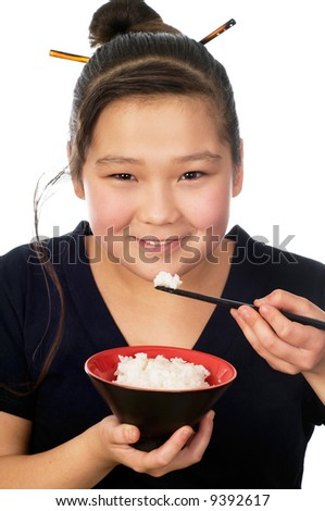 Asian girl eats rice, isolated on a white background. - stock photo
