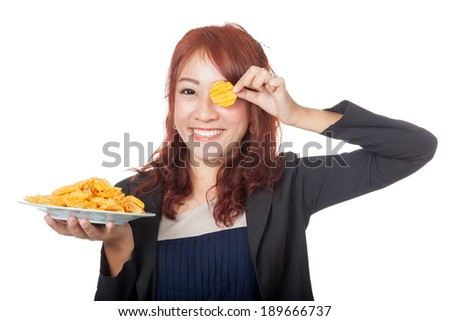 Asian girl  holding a potato chip in front of her eye  - stock photo