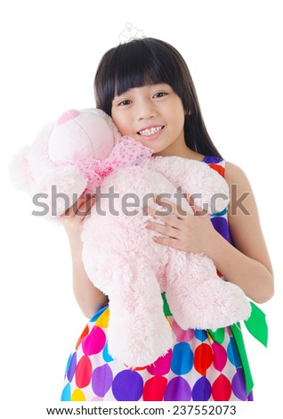 Asian girl holding a toy - stock photo