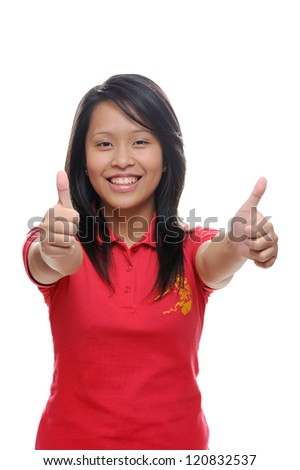 Asian girl in red shirt with thumbs up - stock photo
