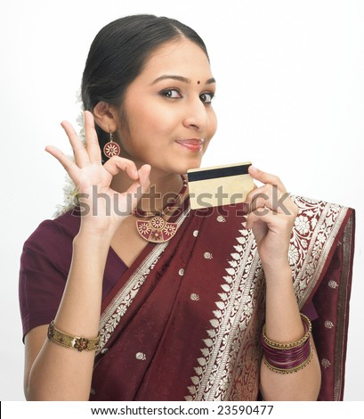 Asian girl in red silk sari with credit-card - stock photo