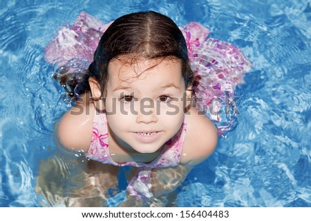 Asian girl in swimming pool - stock photo