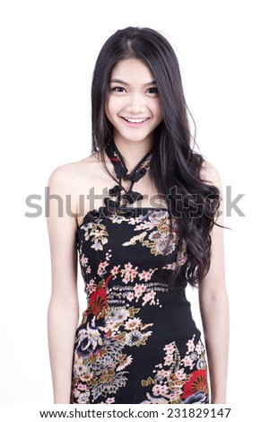 asian girl in traditional Chinese cheongsam greeting, isolated on white background - stock photo