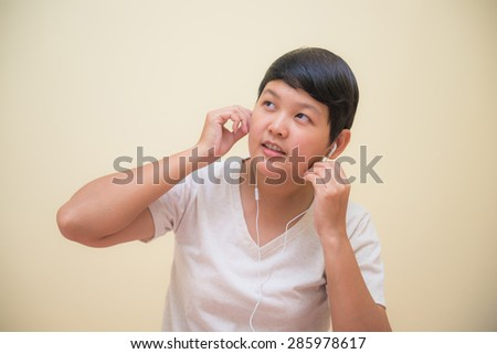 asian girl is listening music by earphone, listen - stock photo