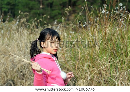 Asian girl playing on the lawn - stock photo