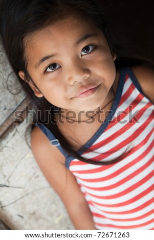 Asian girl portrait - Filipina against wall in natural light - stock photo