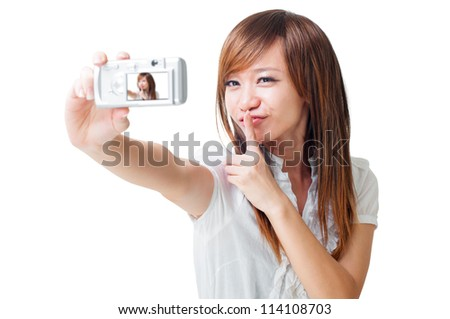 Asian girl self photographing, isolated on white - stock photo