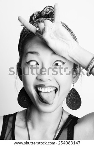 Asian girl showing a goat - stock photo