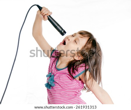 Asian girl singing with a microphone - stock photo