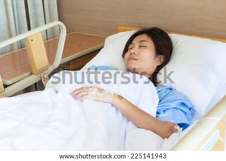 Asian girl sleeping In hospital bed - stock photo