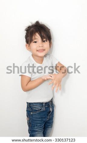 asian girl smile funny action on white - stock photo