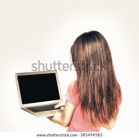 Asian girl standing with laptop. Back view, isolated on white. - stock photo