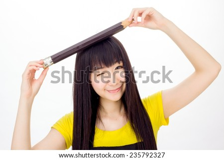 Asian girl student studying with an oversize pencil cute korean  - stock photo