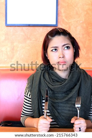 Asian Girl Waiting for Lunch - stock photo