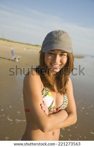 Asian girl wearing hat at beach - stock photo
