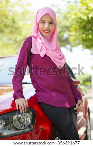 Asian Girl wearing hijab smiling - stock photo