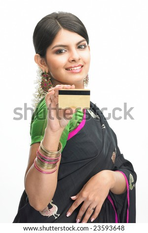 Asian girl with black sari showing the credit-card - stock photo
