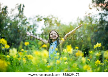 Asian girl with healthy long hair having fun in the meadow, Freedom concept - stock photo