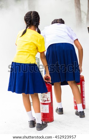 Asian girls are trained firefighters . - stock photo