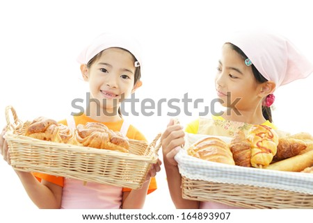 Asian girls carrying breads - stock photo